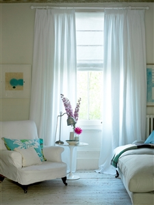 Semi-sheer curtains and Roman blind